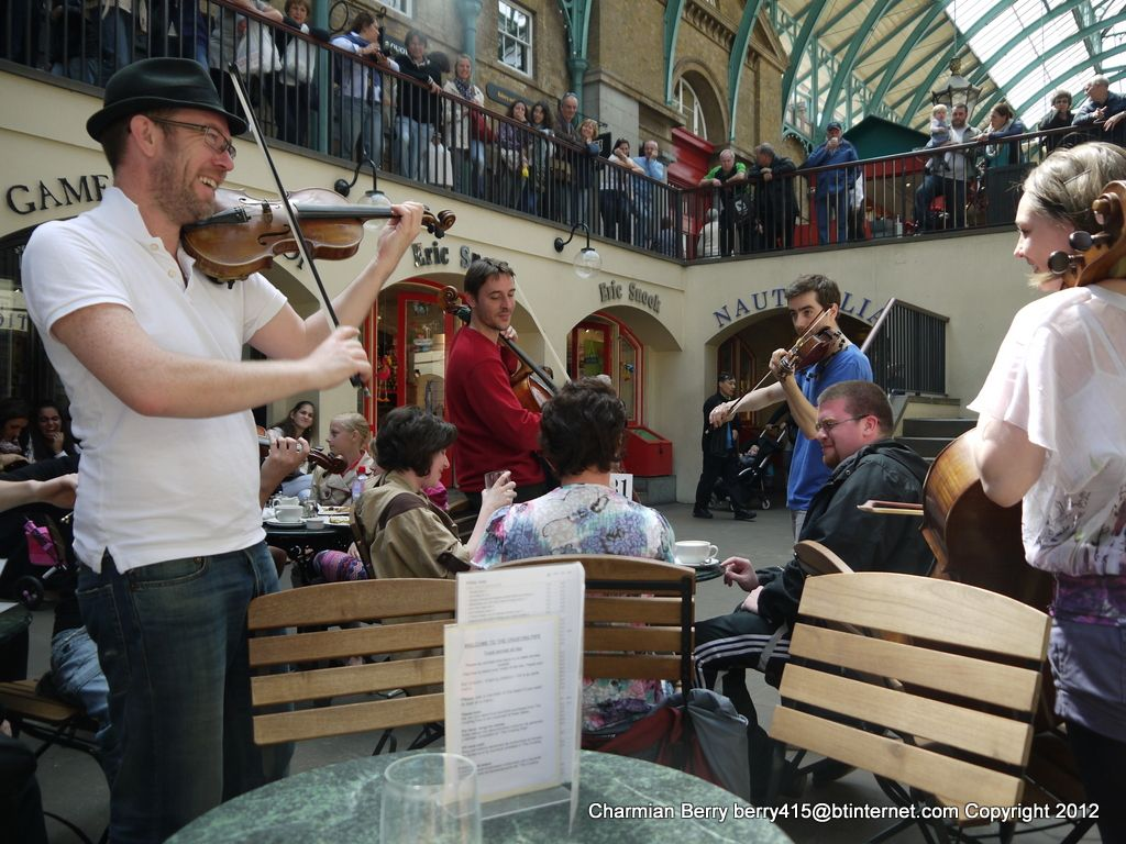 Entertainment in Covent Graden by Charmian S Berry - These are classical musicians who apply for a street entertainment licence and they really do entertain the crowds. They are acomplished musicians but really enjoy themsleves with the crowds that g...