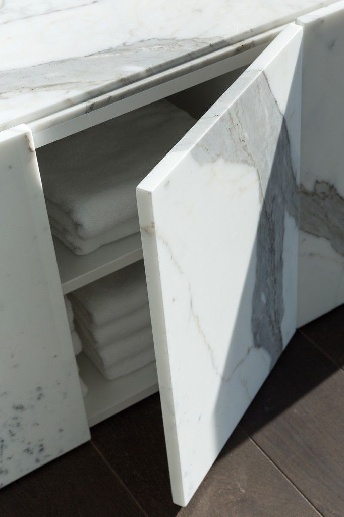 Incredibly Decadent Joinery Clad In Calacatta Marble