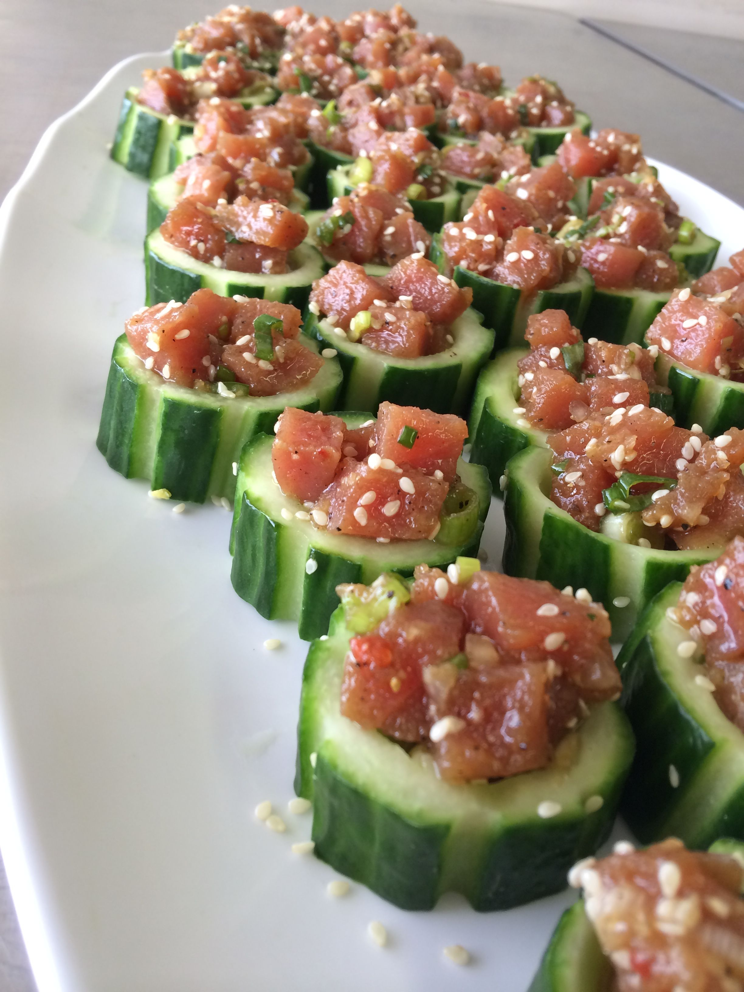 Chilled cucumber cups filled with Ahi Tuna, green onions, and topped with toasted sesame seeds #fresh
