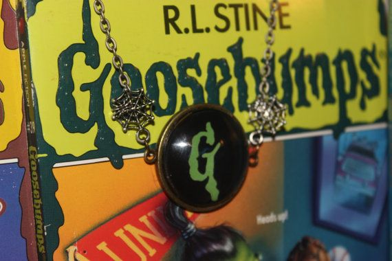 This classic goosebumps charm necklace is sure to bring some nostalgia into the heart of anyone who wears it.