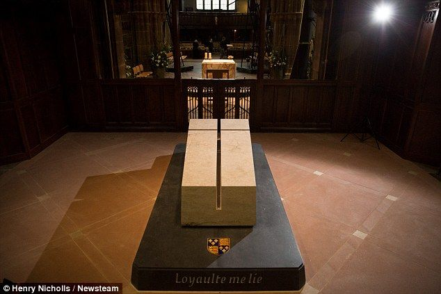 The 2.3-ton tombstone, which features a Christian cross carved on the top, was lifted  into place overnight at Leicester Cathedral