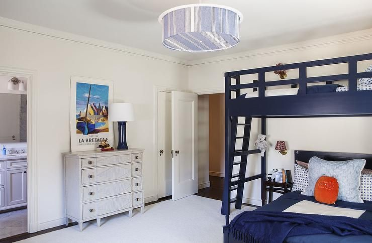Navy Boys Room Features A Blue Striped Drum Pendant