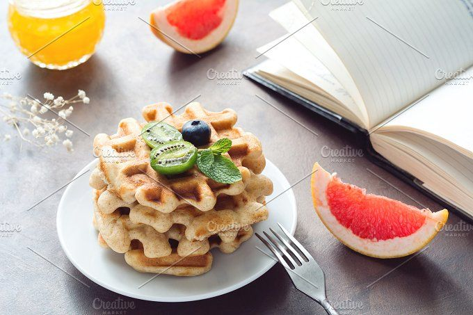 Breakfast with waffles and fruits by The baking man on @creativemarket
