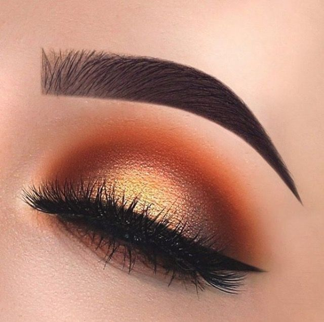 Orange crease with brown inner and outer corners, and a gold shimmer lid. Love this eye makeup look.