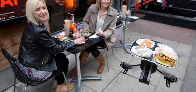 thisbigcity:  springwise:   drones In the UK, flying drone delivers food to restaurant tables If the organizers of theOppiKoppimusic festival in South Africa think delivering beer by drones is a workable idea, could restaurants use the devices to send food to diners' tables? The UK's YO! Sushi has developed theiTray, a flying robot that is able to do just that. READ MORE…  The future has arrived, folks.