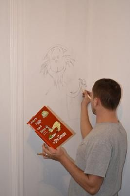 Dad Making Sketches Of Our Favorite Dr. Seuss Illustrations On The Nursery  Wall: The