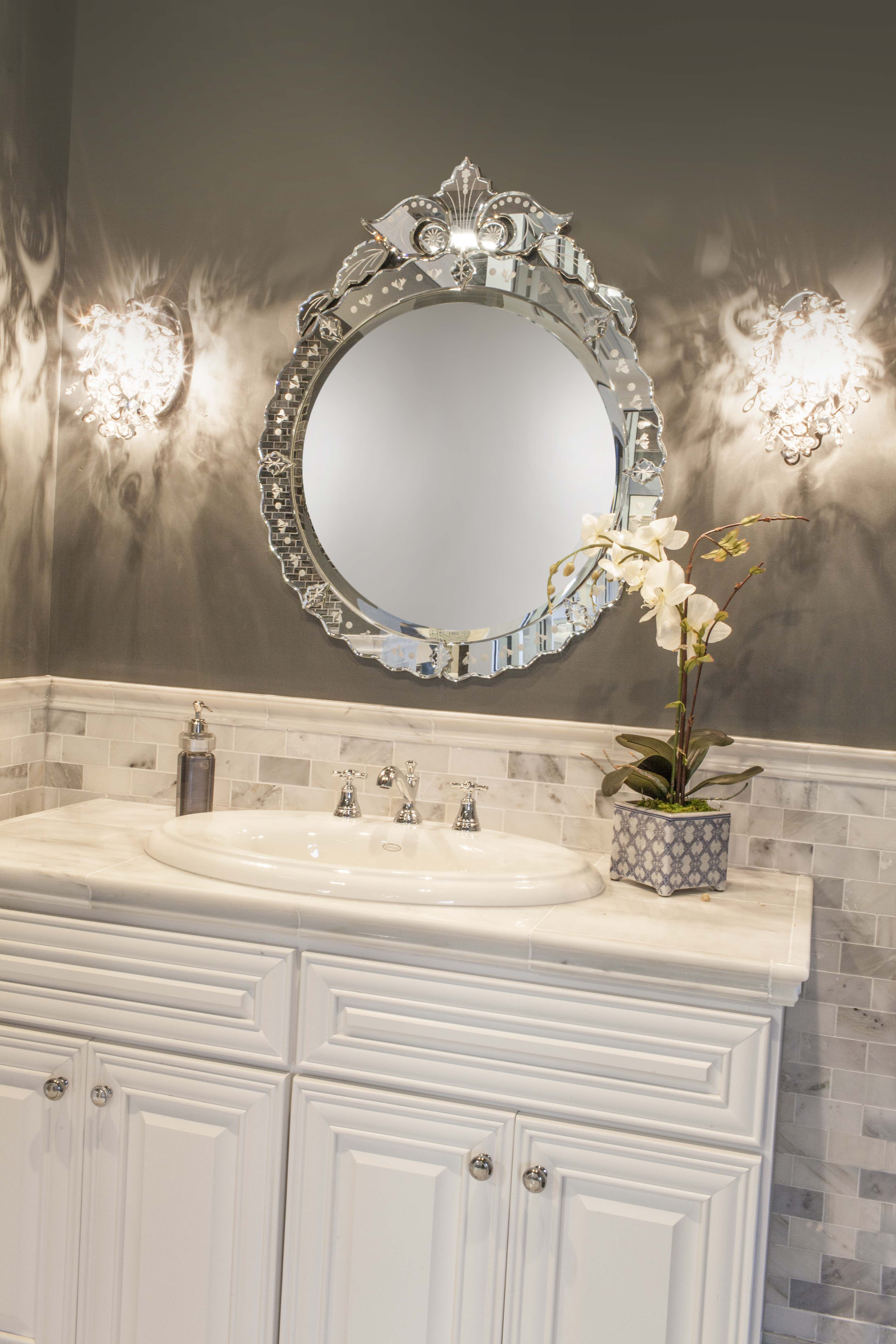 Glamorous marble vanity with matching subway tile wainscoting ...
