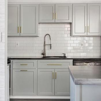 stunning gold and gray kitchen remodel with white subway tiles gold hardware cabinets painted on kitchen cabinets gold hardware id=92725