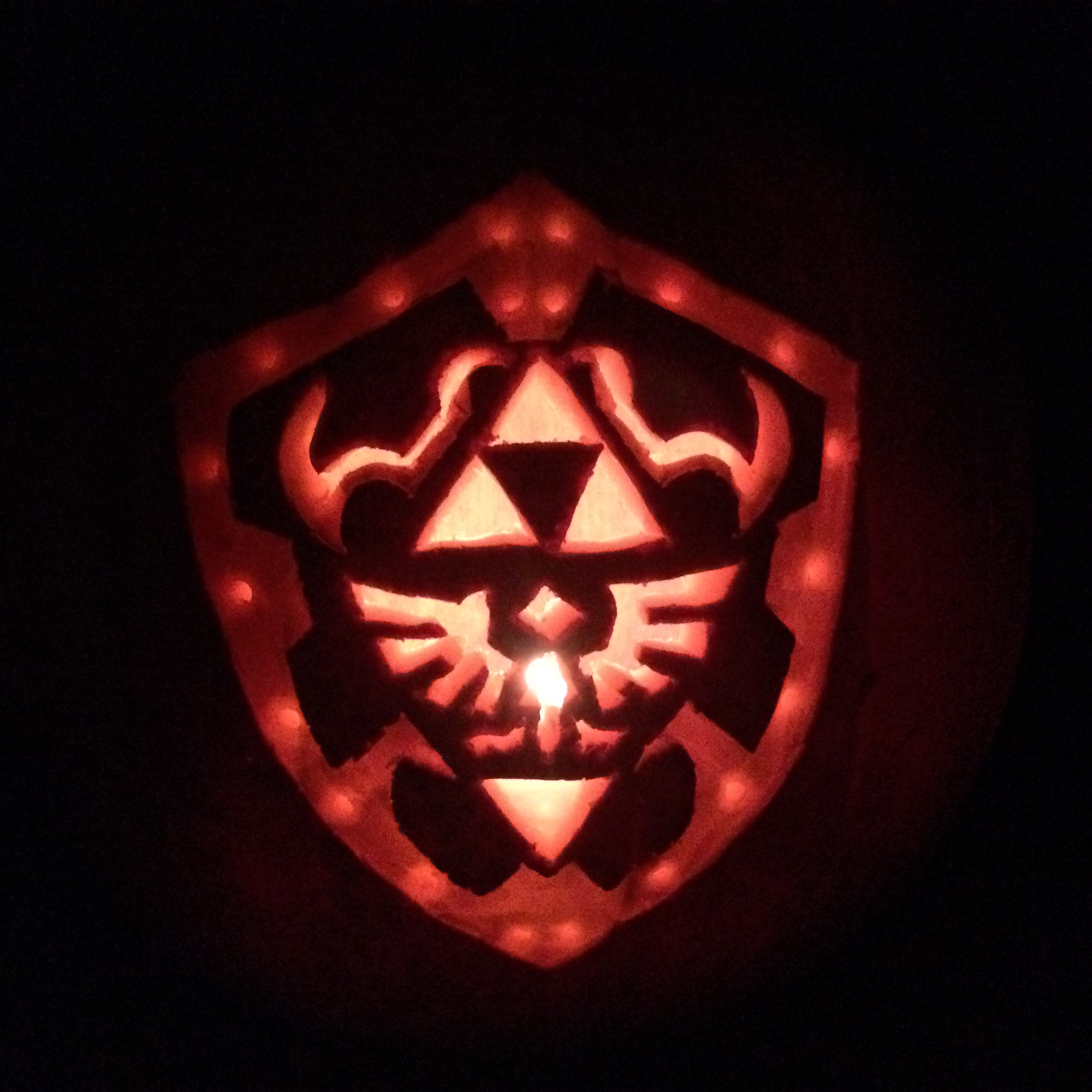 My pumpkin carving for this year a Hylian Shield