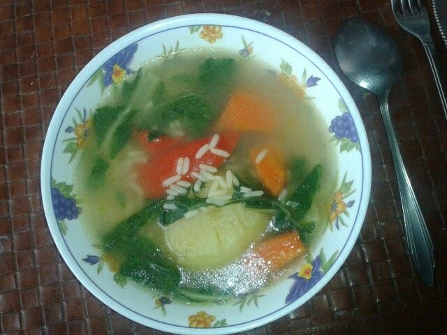 Home made soup with rice spinnach carrot red pepper and potato :)