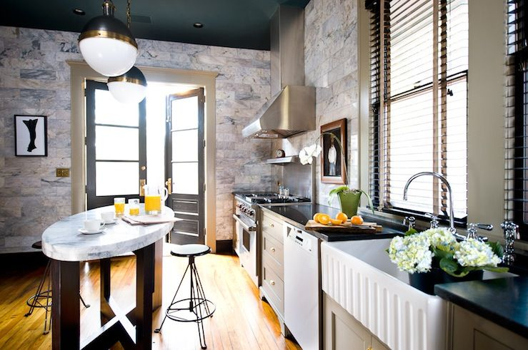 I like how this kitchen's walls are stone...not just the backsplash. Could make our kitchen cool.