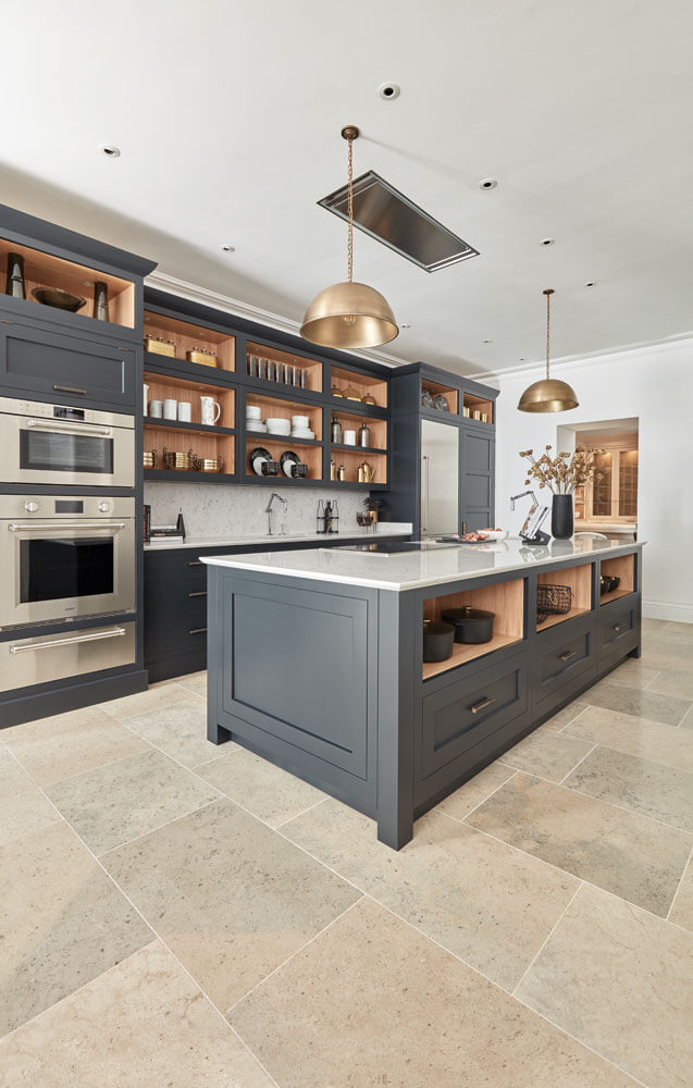 Dark Grey Shaker Style Kitchen - Shaker style kitchens, Shaker style kitchen cabinets, Grey kitchen designs, Kitchen styling, Kitchen cabinet styles, Grey shaker kitchen - This impeccable dark grey shaker style kitchen brings a classic concept bang up to date  The handpainted finish echoes the quality and craftsmanship that has gone into every inch of the design and build  Typical shaker style open shelving is given a contemporary twist with discreet lighting to showcase gleaming copperware  The design promotes a …