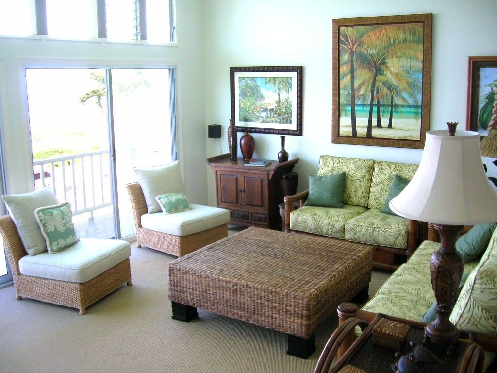 Captivating Featured : Mesmerizing Tropical Living Room Decorating Ideas Featured  Rattan Table And Small Wooden Sofa Sets