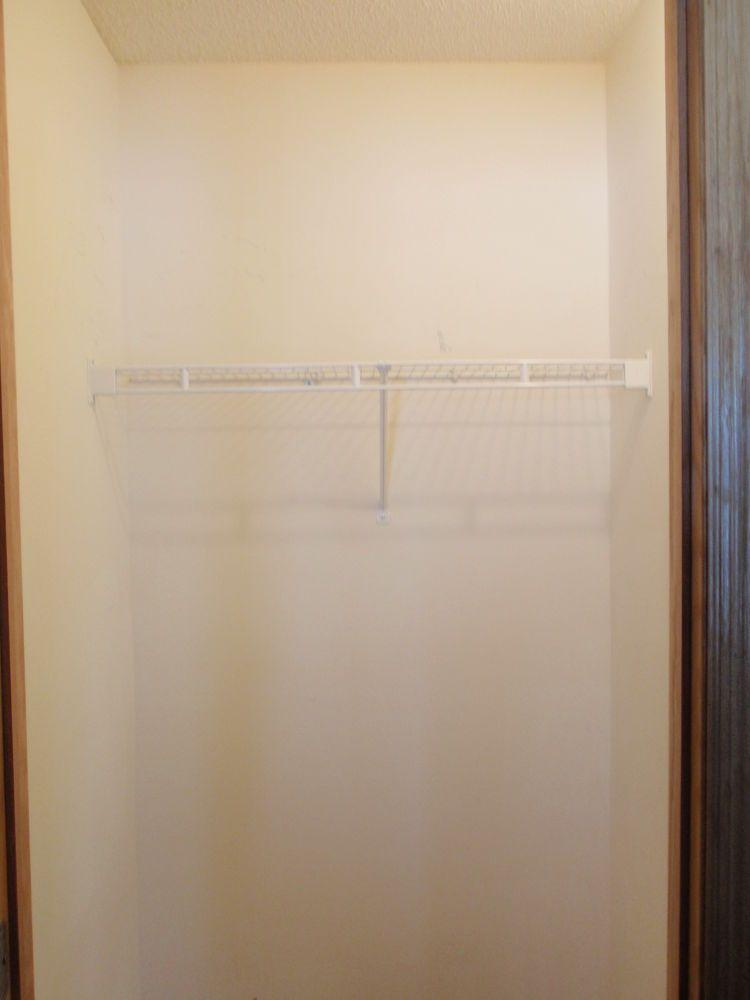Coat Closet Made Into a Simple Walkin Pantry