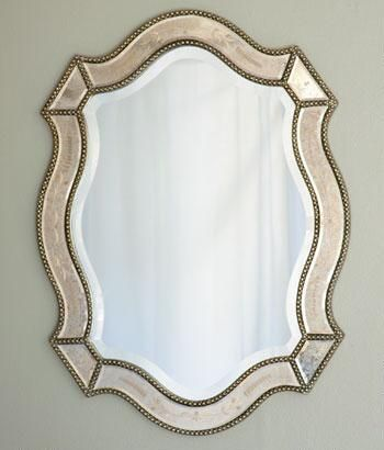 This is a good size for above your lingerie chest ~ more decorative than functional; brings in that soft metallic to help blend shapes & styles in an eclectic direction.  Cara Mirror $229.95