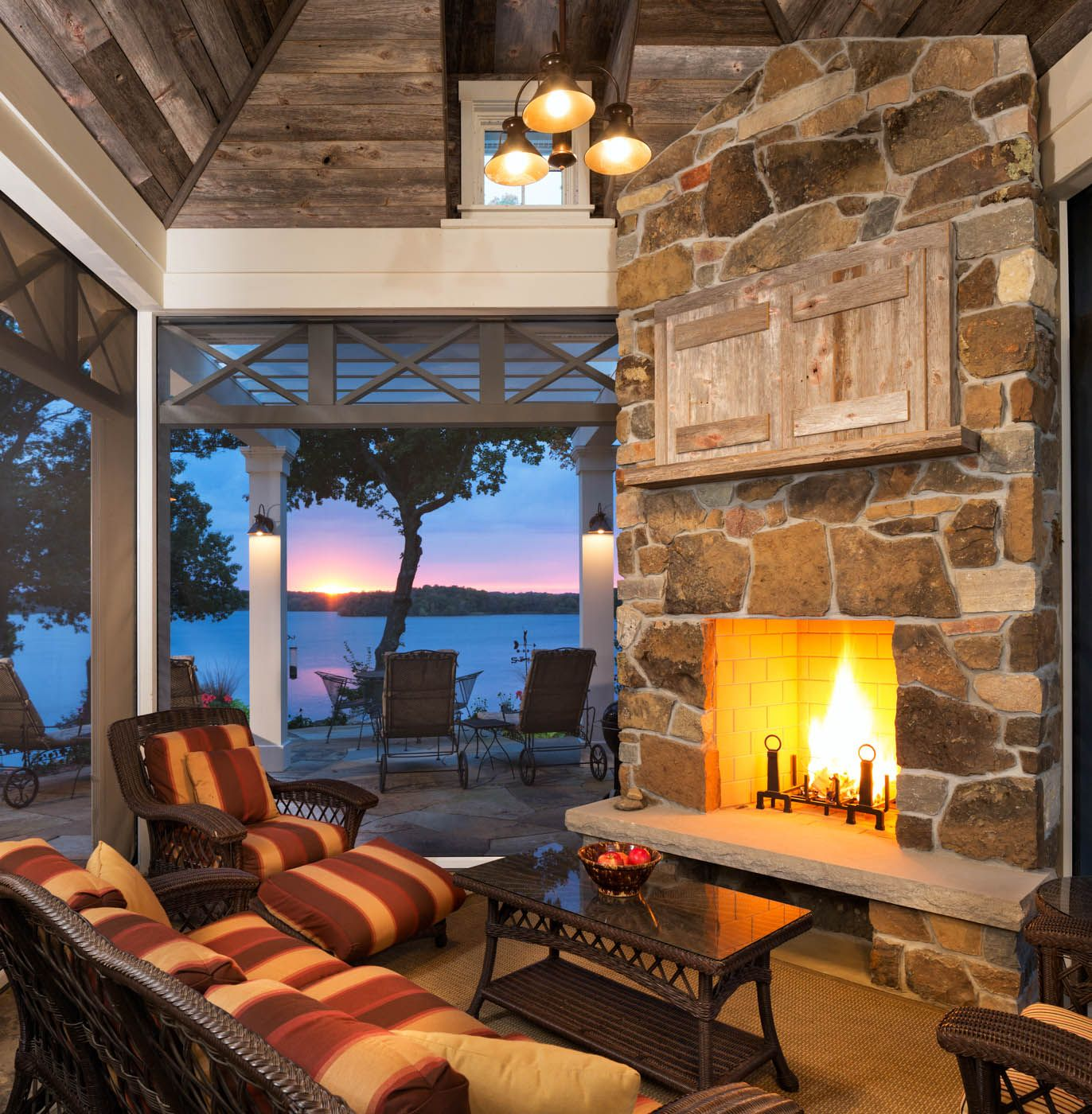 Breathtaking covered patio with stone fireplace and killer views ...