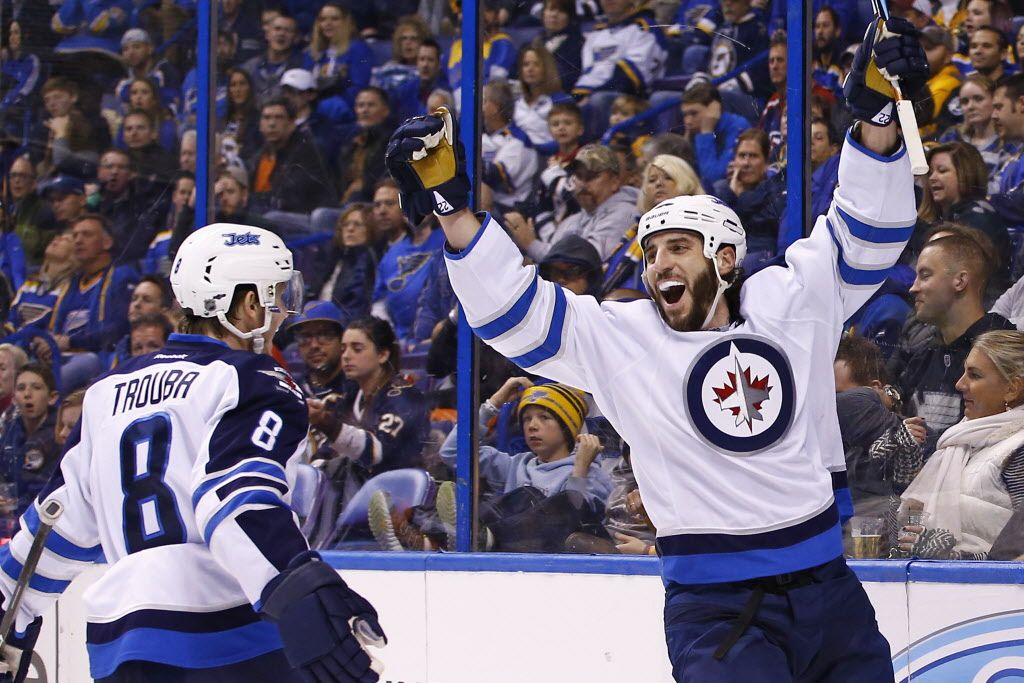 Winnipeg Jets Chris Thorburn Right Celebrates With Jacob Trouba After Scoring A Goal Against The St Louis Blues During T Winnipeg Jets Jets Hockey Nfl Fans