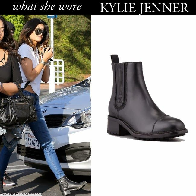 Kylie Jenner in black leather ankle