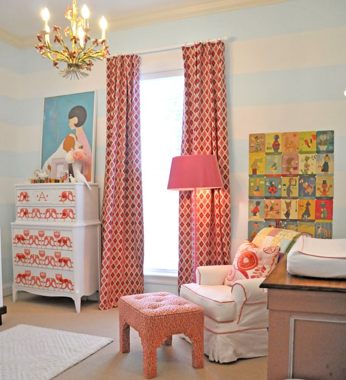 This is very subtle with the blue striping on the walls...but look at drapery and the accents in the bright colors...just replace the pink tones with red tones...sweet chandelier too...