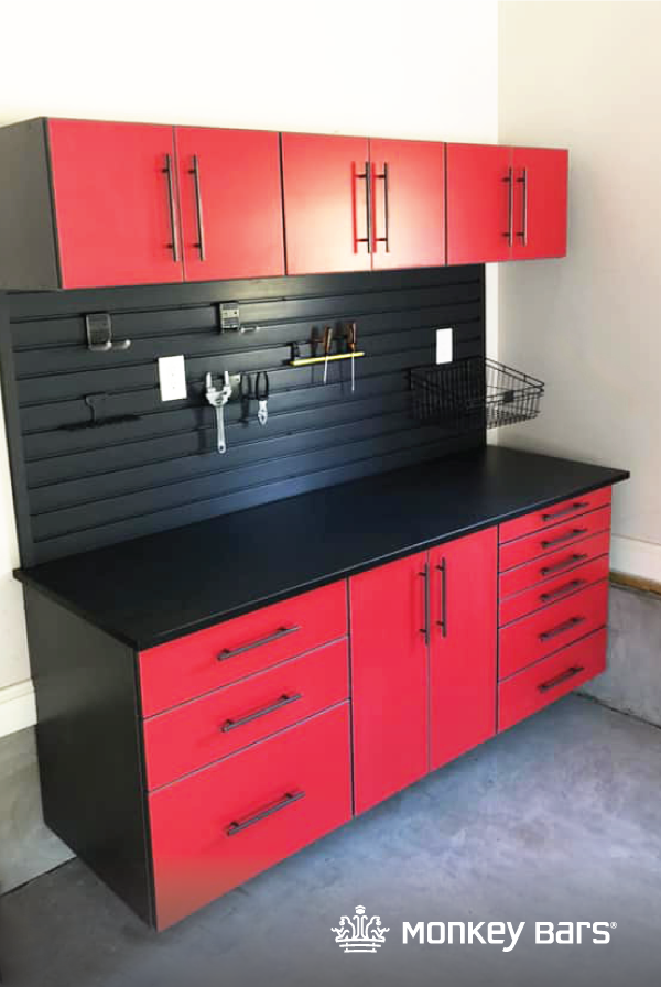 Race Day Red Cabinets Paired With Black Slatwall Makes For