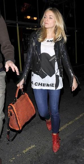 Who made Sienna Miller's white print tee, bag, black leather jacket and red boots that she wore on March 17, 2011? Jacket – Burberry Shoes – Chloe Purse – Prada Shirt – TWENTY8TWELVE