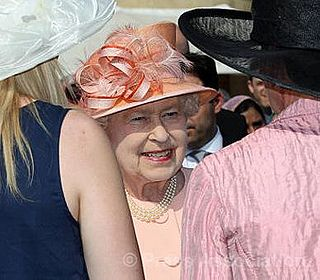 The Queen meets guests at a Garden Party by The British Monarchy, via Flickr