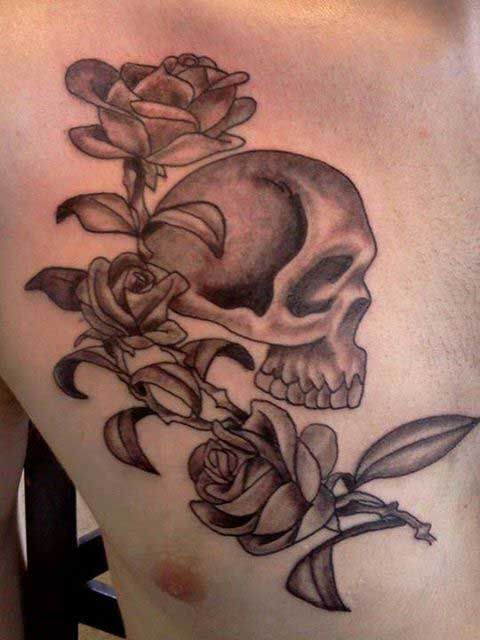 Small Skull And Roses Tattoo On Chest For Men Rose Tattoos Tattoos
