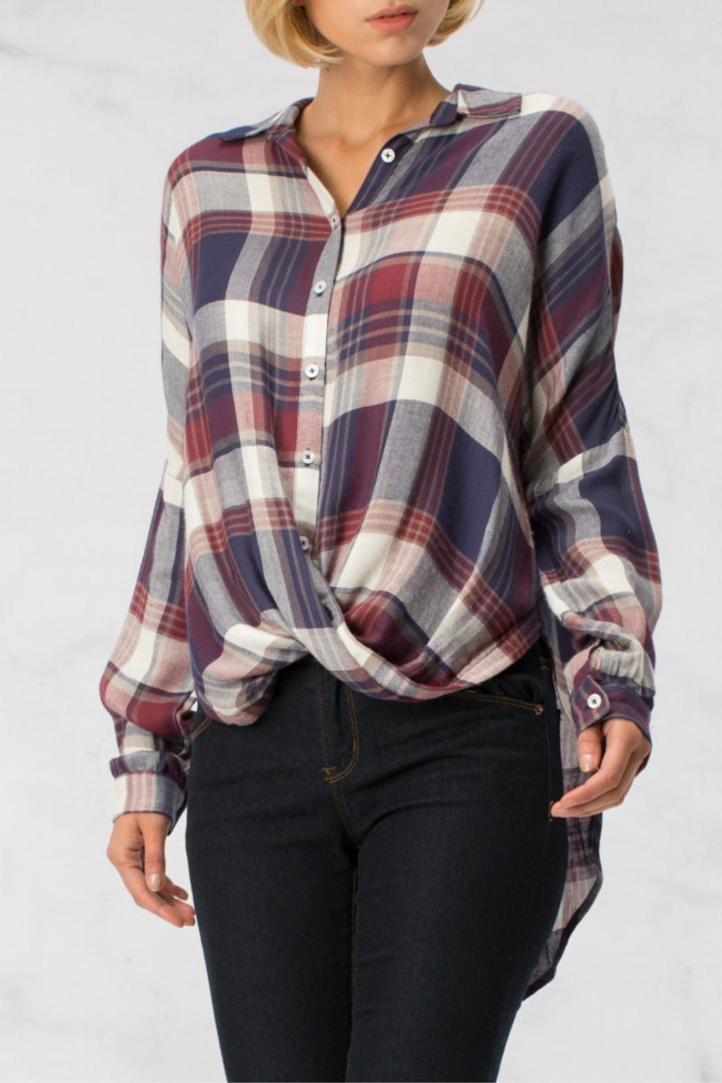 Plaid is everywhere this fall and we love these oversized tunics! Button-down with a twist-front making the hem longer in back.   Oversized Twisted Plaid Tunic by HYFVE. Clothing - Tops - Tunics Branford, Connecticut