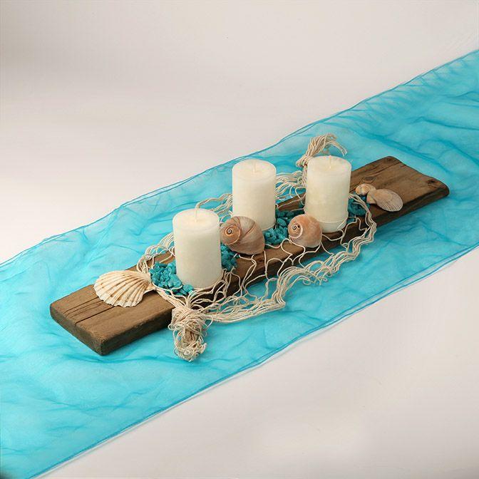 Dekoratives Holz-Brett türkiser Ozean mit Muscheln und Fischernetz