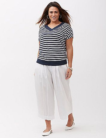 This wedge tee is perfect for when you don't want to deal with sleeves but aren't quite feeling a tank. The double-V neckline takes it into way-beyond-basic territory too. Banded bottom. lanebryant.com