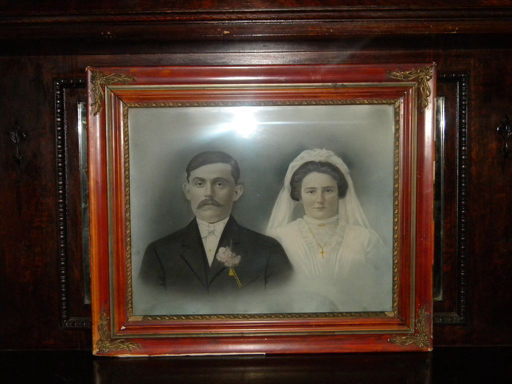 Antique wedding bride and groom painting in antique victorian frame