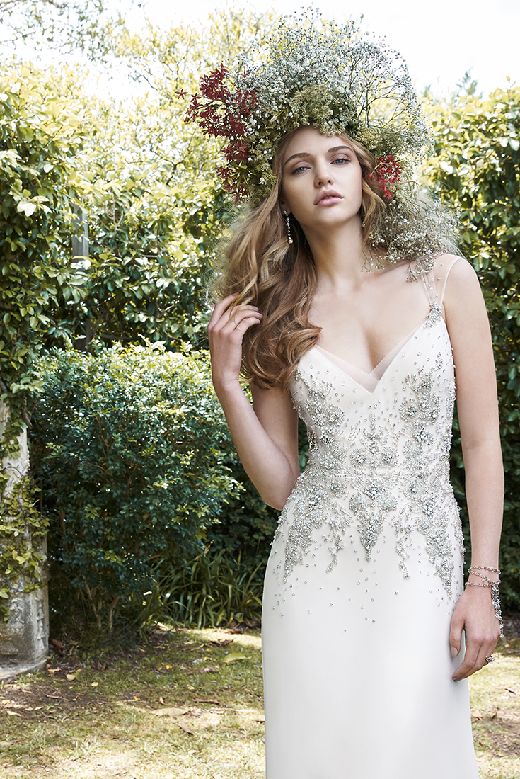Lightweight wedding dresses  A soft and lightweight chiffon wedding dress with deep vneckline