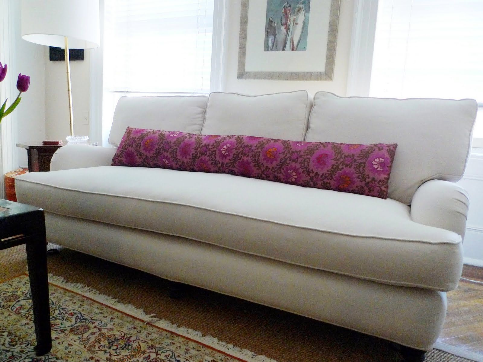 Beautiful pillow on the single cushion sofa