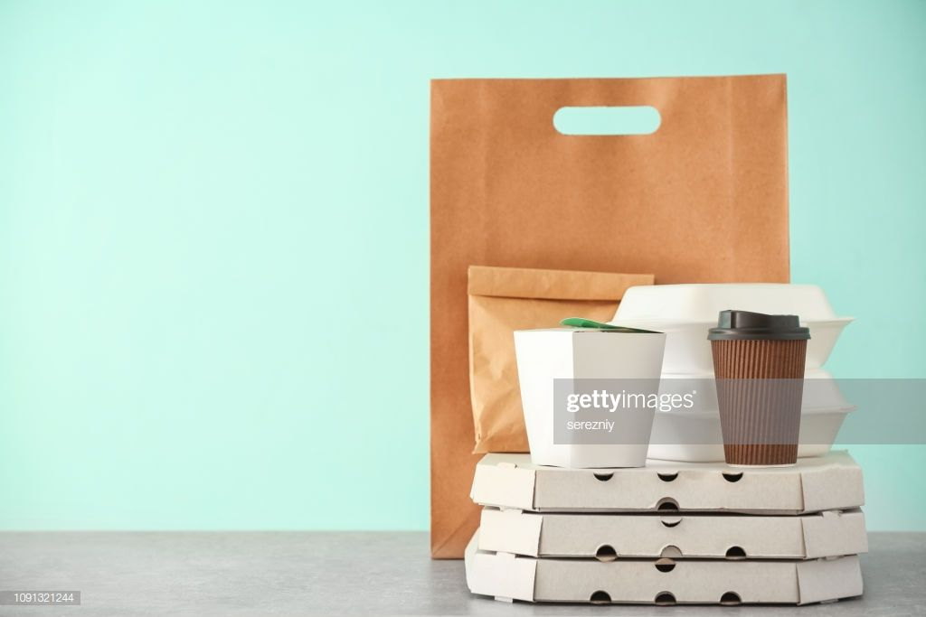 Different Packages On Table Against Color Background Food Delivery Food Delivery Meal Delivery Service Paper Packaging