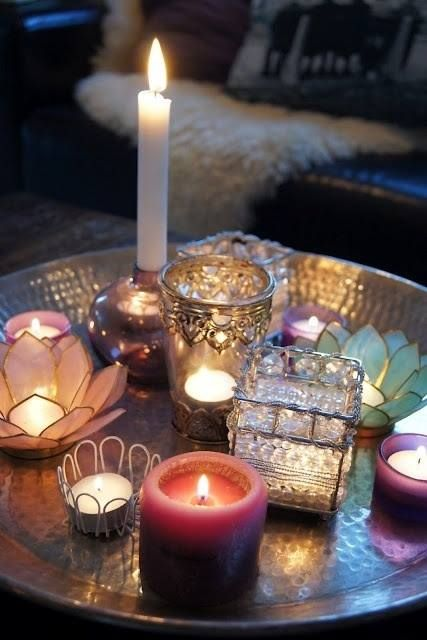 Candles ~ We all have a collection of holders we no longer use.. arrange them randomly on a tray and Voila, you have a lovely coffee table centre piece.