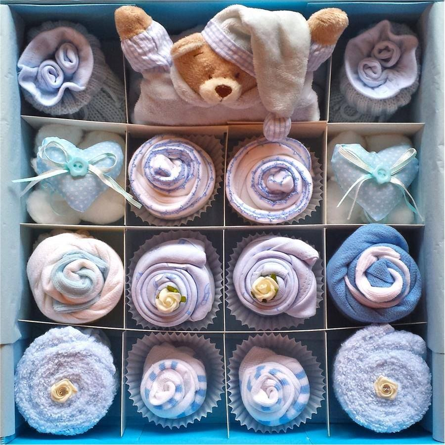 Super Deluxe Blue Cupcake Set £50.98  Our unique cupcake gift sets are so cute and the perfect gift for a little baby boy. These cupcakes can also be a wonderful centre piece at a baby shower.   All cupcake gift sets are presented in our gorgeous keepsake gift boxes. Then gift wrapped in colour coordinated cellophane with a hand made gift card.