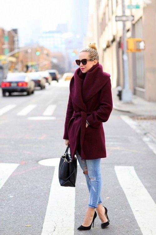Shop this look for $119:  http://lookastic.com/women/looks/burgundy-overcoat-and-black-shopper-handbag-and-light-blue-jeans-and-black-heels/908  — Burgundy Overcoat  — Black Tote Bag  — Light Blue Jeans  — Black Heels