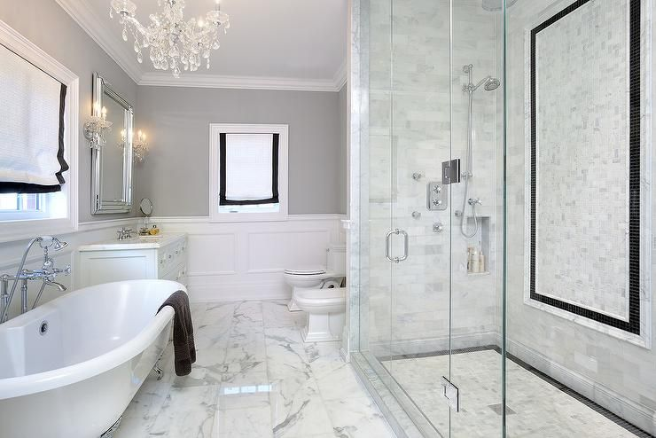 A Seamless Gl Shower Boasts White Mosaic Marble Grid Tiles Finished With Black Border And