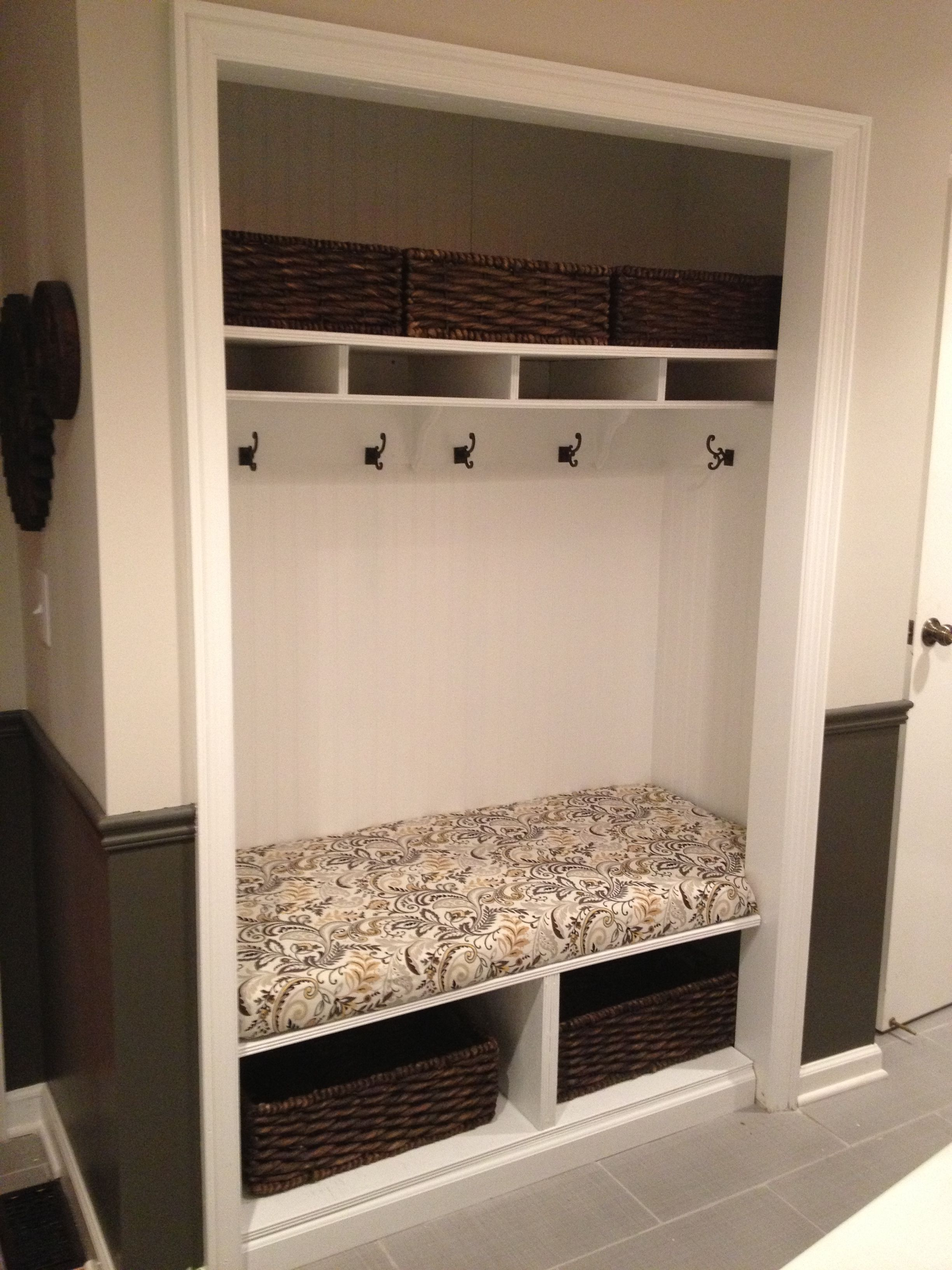 Unused mudroom closet converted into a bench with hooks for Building a mudroom bench