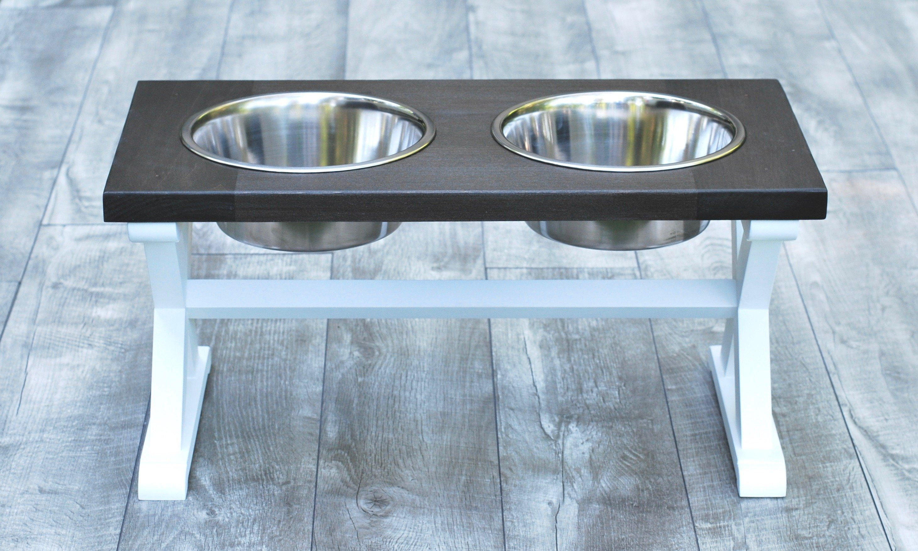"The perfect accessory for your home that makes less mess. Is your dog a bit of a messy eater? These raised dog bowl stands are not only lovely accessories for your home but also help the less-than-tidy pups keep their eating area clean. Whether you have a lazy Labrador or a spilly Shepherd this beautifully crafted ""X"" pattern two-bowl raised feeder will make cleanup a breeze. The two stainless steel bowls are dishwasher safe and the table is built and designed to stand up to even the roughest an"
