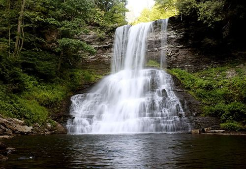 """The Cascades waterfall in Giles County, Virginia.Giles County is the location of Mountain Lake, one of only two natural fresh water lakes in Virginia. The Lake drains into Little Stony Creek, which passes over """"The Cascades"""", a spectacular waterfall, before reaching the New River.  Photo copyright Jesse Hutcheson"""