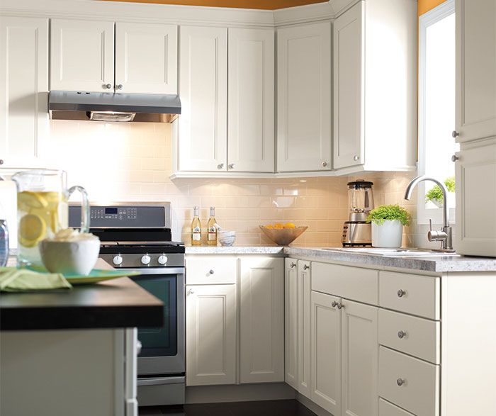 Like a blank canvas kitchen cabinets in French Vanilla offer the