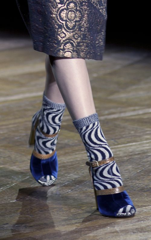 Dries Van Noten Fall 2011.  Funky socks on the runways can only be good news for sock knitters.  No more need to hide those socks under your trouser legs, ladies.