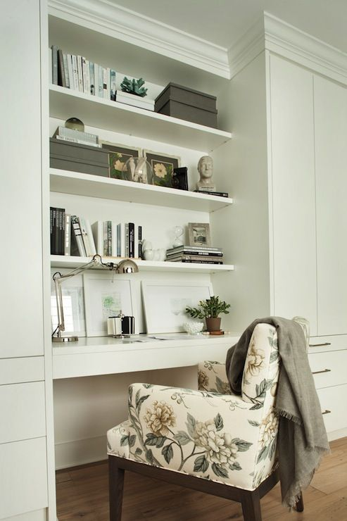 Beautiful Home Office With Built In Shelving And A White Floating Desk Flanked By Ceiling Height