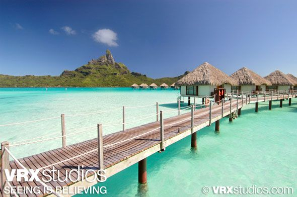 This breathtaking photo of the lagoon at Le Méridien #BoraBora showcases a row of traditional Polynesian huts set above the crystal clear ocean. View more stunning photography here: http://www.vrxstudios.com