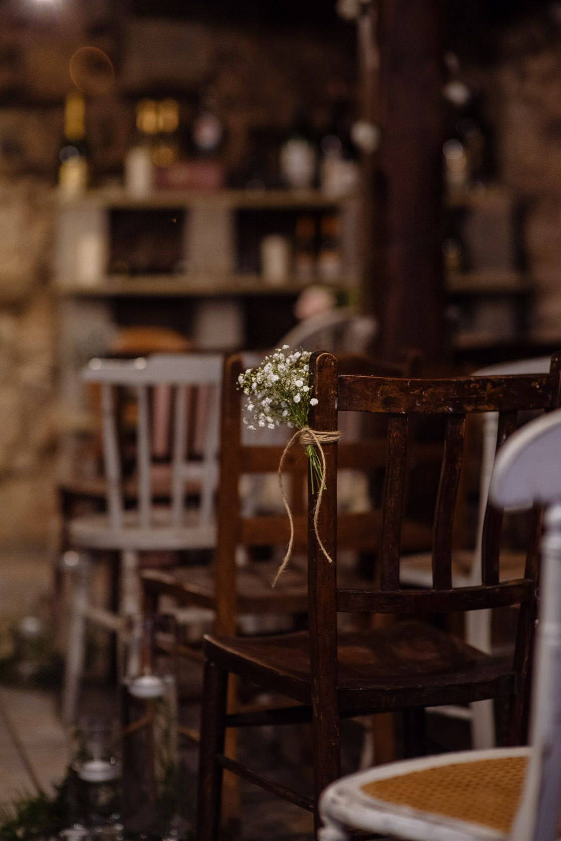 Barn wedding decoration ideas  Mis matched chairs for barn wedding ceremony with simple rustic