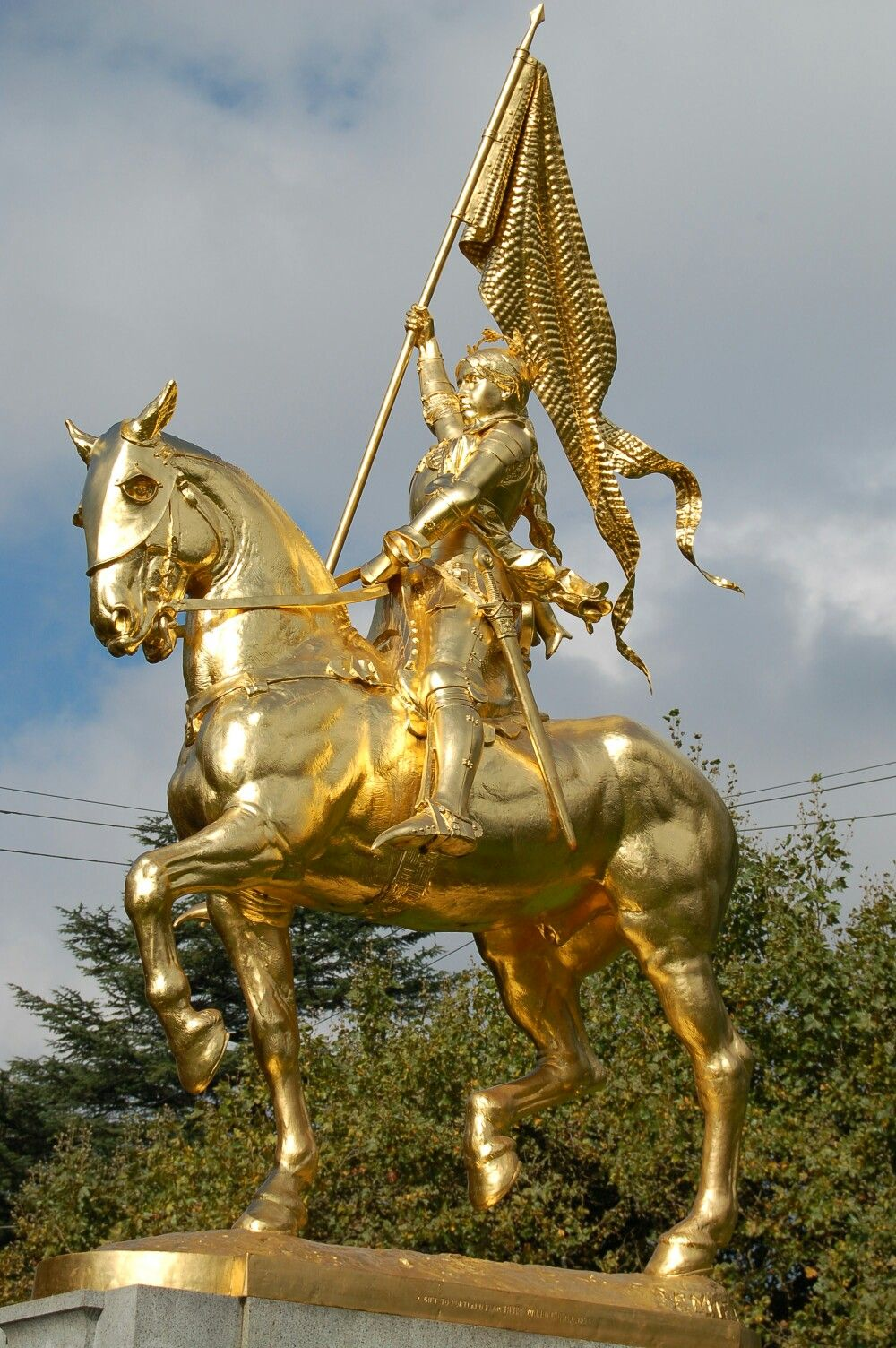 Gold statue titled, \