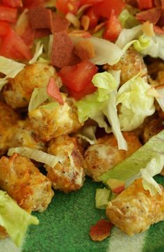You know what is awesome? BLT Tots. That's right, smokey bacon, bright lettuce, and sweet tomatoes on top of hot and crunchy tater tots. Of course the whole thing is brought together by adding tangy sour cream mixed with some Italian seasoning and melted cheese. BOOM! You are totally going to win your Big Game party with these ultimate BLT Tater Tots! Click through for the recipe.
