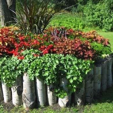 Log Edging   DIY Garden Edging   Bob VilaOn the Edge  16 Garden Borders You Can Make   Garden borders  . Diy Landscaping Borders. Home Design Ideas