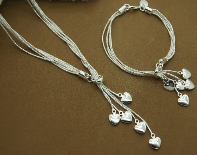 Silver Heart Necklace and Heart Bracelet Fashion Jewelry Set. $18.99, via Etsy.